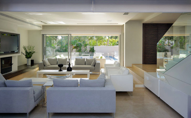 open Living room with grey and white sofas