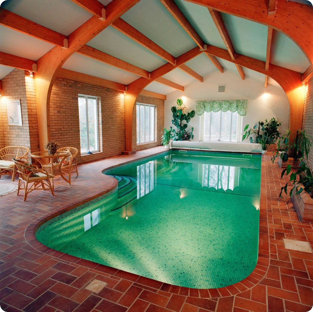 Indoor swimming pool designs home designing for Beautiful house designs with swimming pool