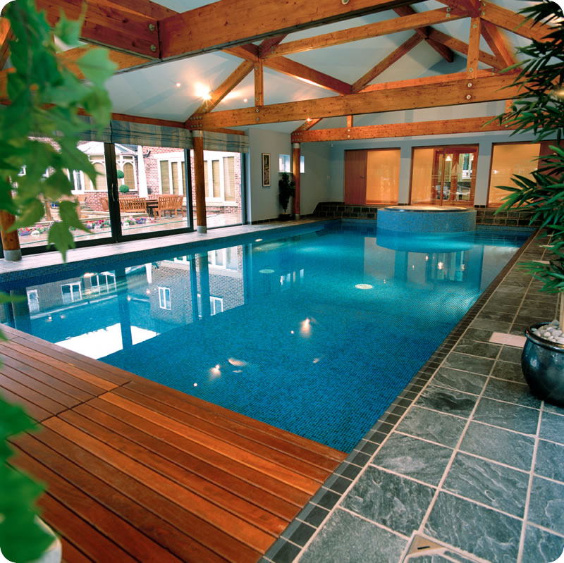 Indoor swimming pool area with woodern work