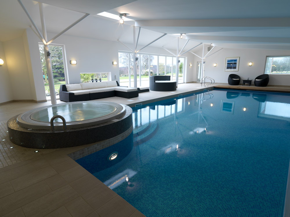 Indoor swimming pool with sitting area