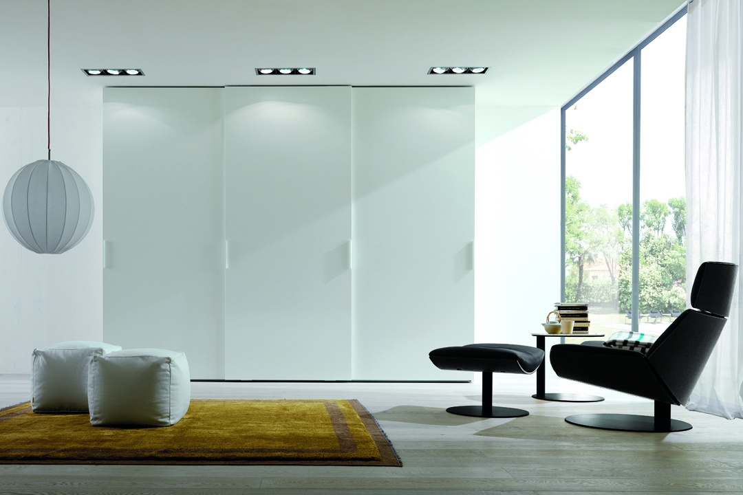 Sliding wardrobe in white color design