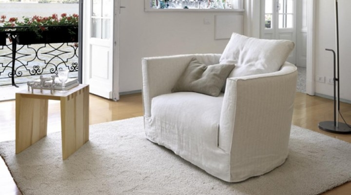 White sofa chair with cusions