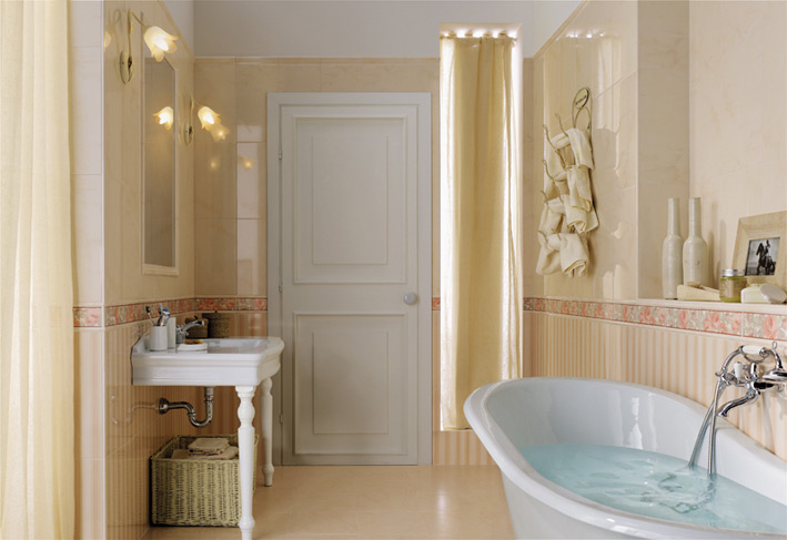 cream color bathroom with a bathtub
