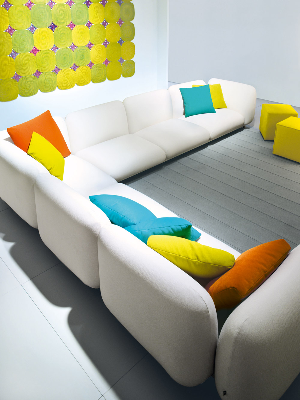 White Sofa with colored Cusions