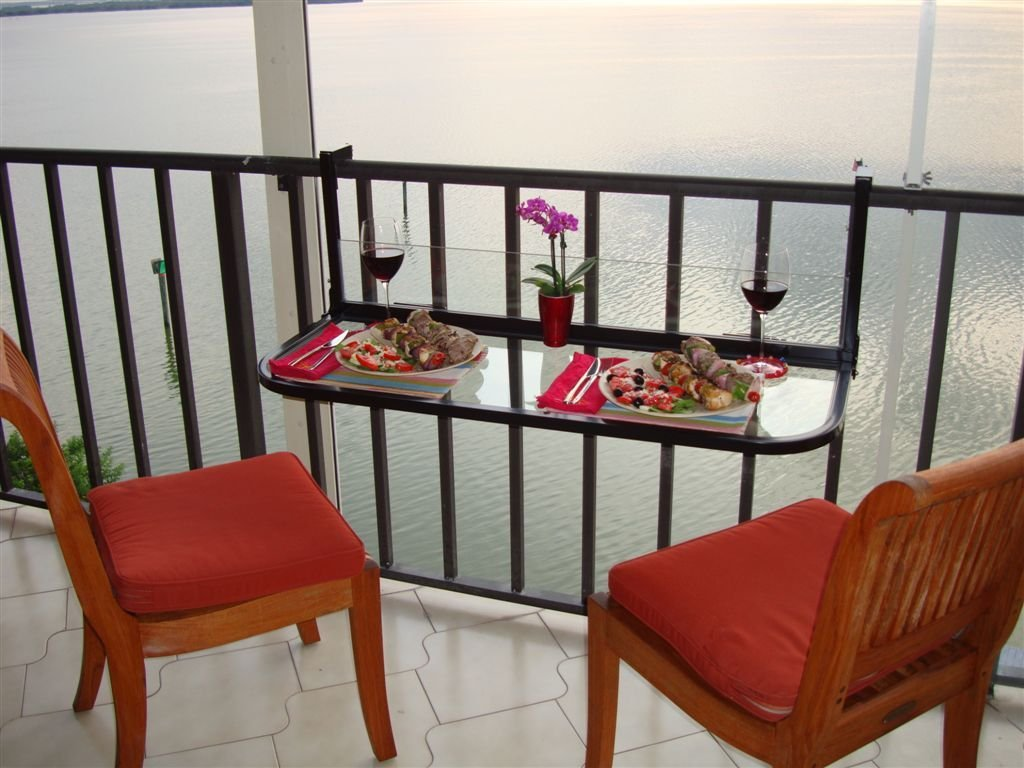 Space saving table for small balconies home designing for Outside balcony furniture